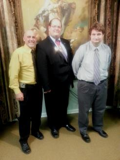 347638-kevin-comeaux-left-and-matthew-spitznagel-right-state-deputy-vernon-ducote-offers-his-congratulations-to-them-making-2nd-and-3rd-degree-on-october-4-2014