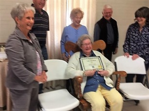 bonnie naquinladyofmonth-bonnie with lady of the month certificate standing mary lynn, jim cazes, gloria and jerry curtis, and sarah